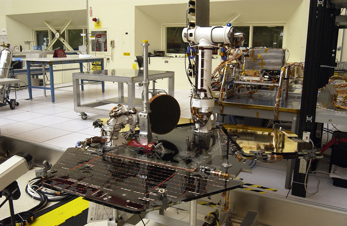 Rover 2 equipment deck, with solar arrays partially deployed, in JPL's Spacecraft Assembly Facility's cleanroom.
