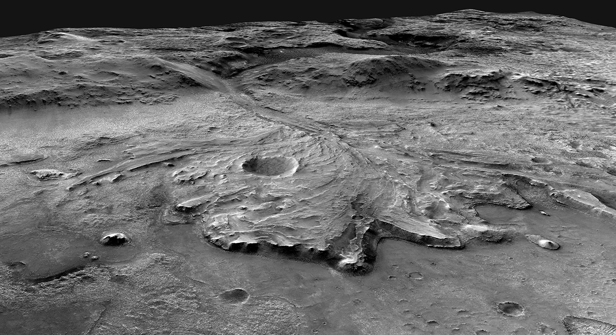 Oblique view looks to the west above Jezero Crater floor over the fan-shaped delta and into the valley that cuts through the crater rim. The illustration was generated by U.S Geological Survey using data from NASA spacecraft.