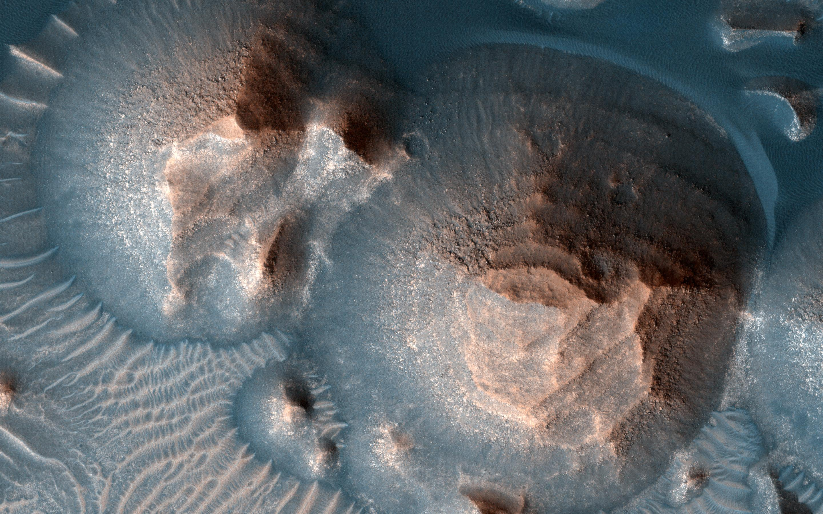 This image acquired on October 1, 2020 by NASAs Mars Reconnaissance Orbiter, shows several craters in Arabia Terra filled with layered rock.