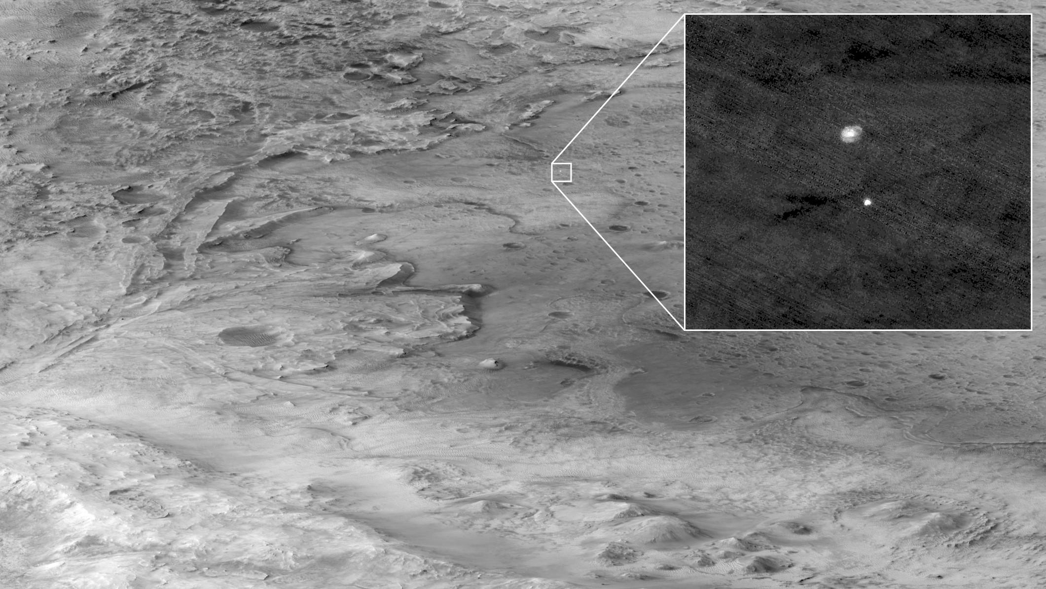 descent stage holding NASAs Perseverance rover can be seen falling thorough the Martian atmosphere