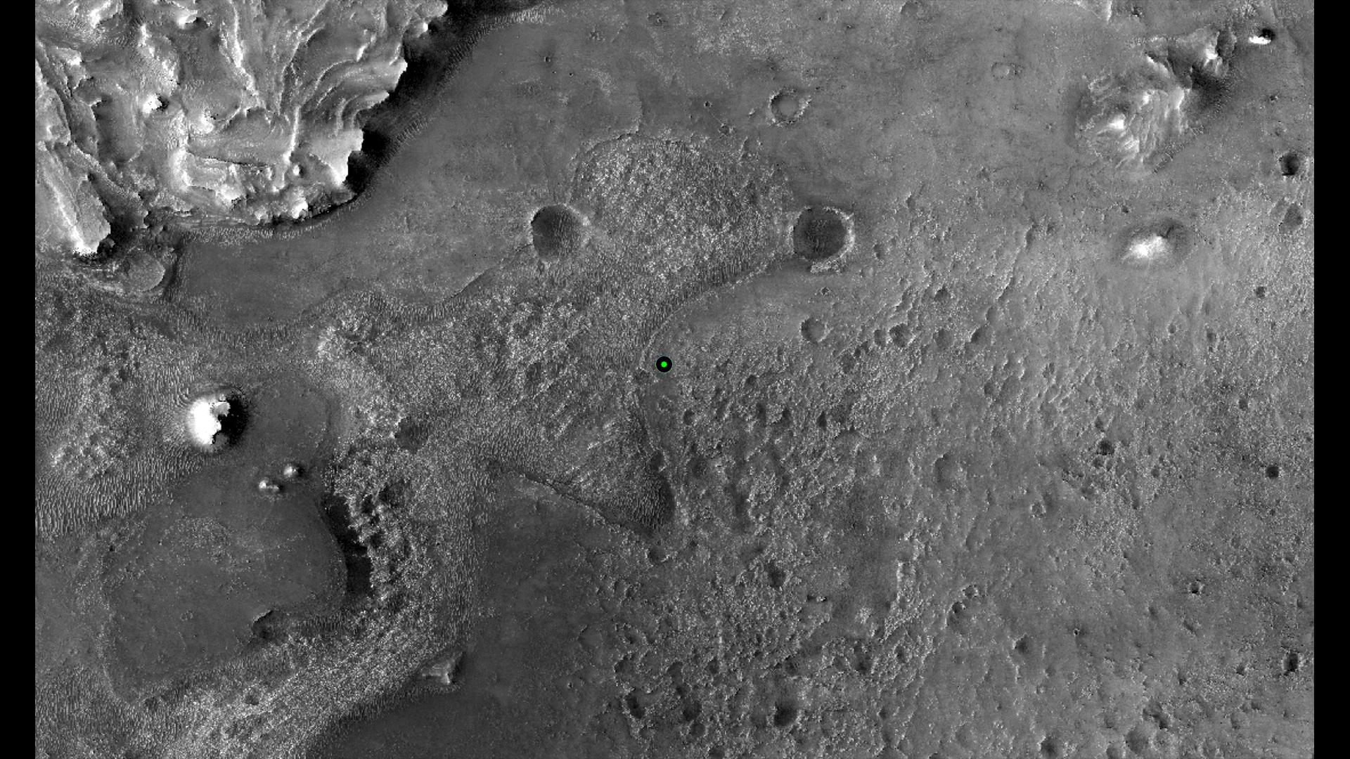 This image shows with a green dot where NASAs Perseverance rover landed in Jezero Crater on Mars on Feb. 18, 2021. The base image was taken by the HiRISE camera aboard NASAs Mars Reconnaissance Orbiter.