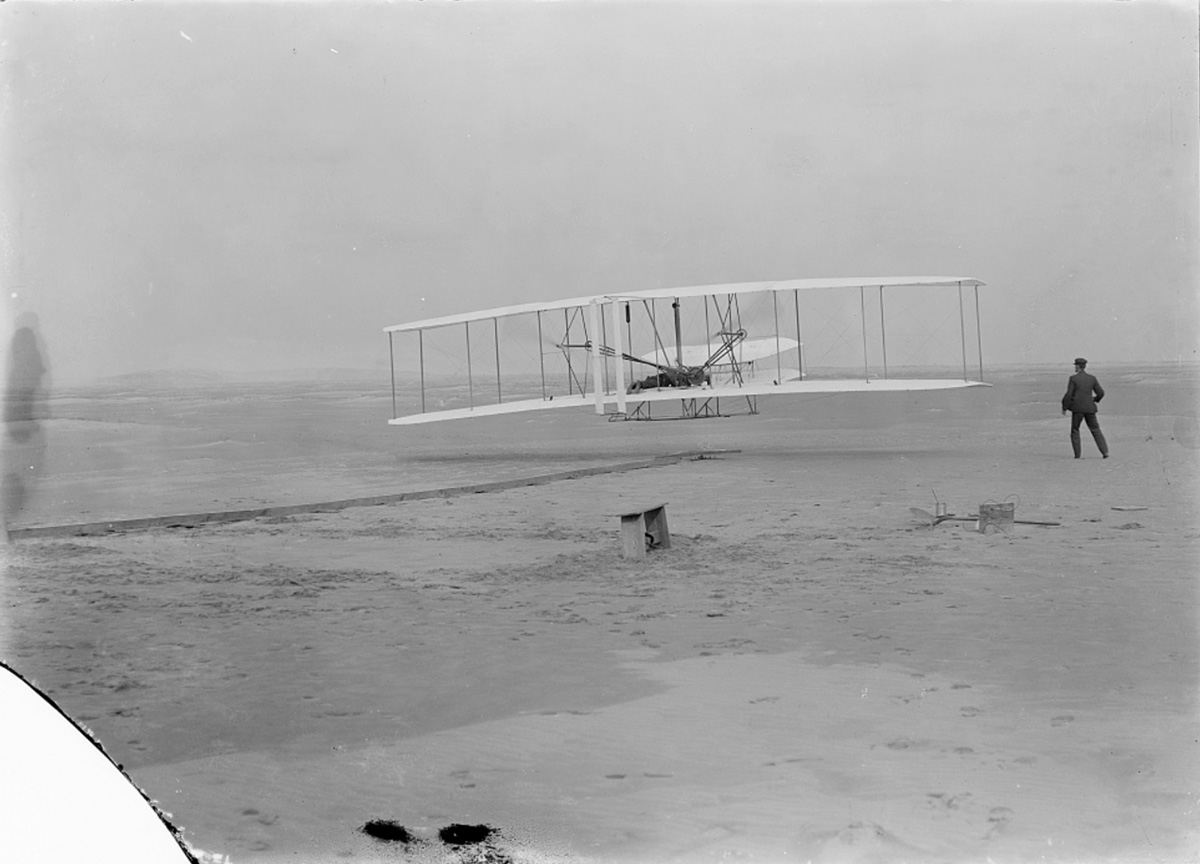 Orville Wright makes the first powered, controlled flight on Earth at Kitty Hawk, North Carolina, on Dec. 17, 1903.