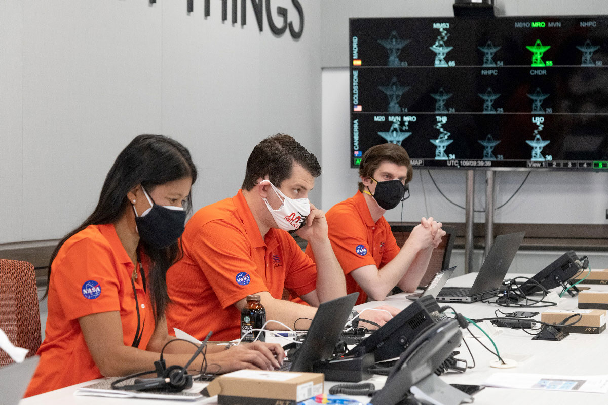 Members of NASA's Ingenuity helicopter team in the Space Flight Operations Facility at NASA's Jet Propulsion Laboratory prepare to receive the data downlink showing whether the helicopter completed its first flight on April 19, 2021.