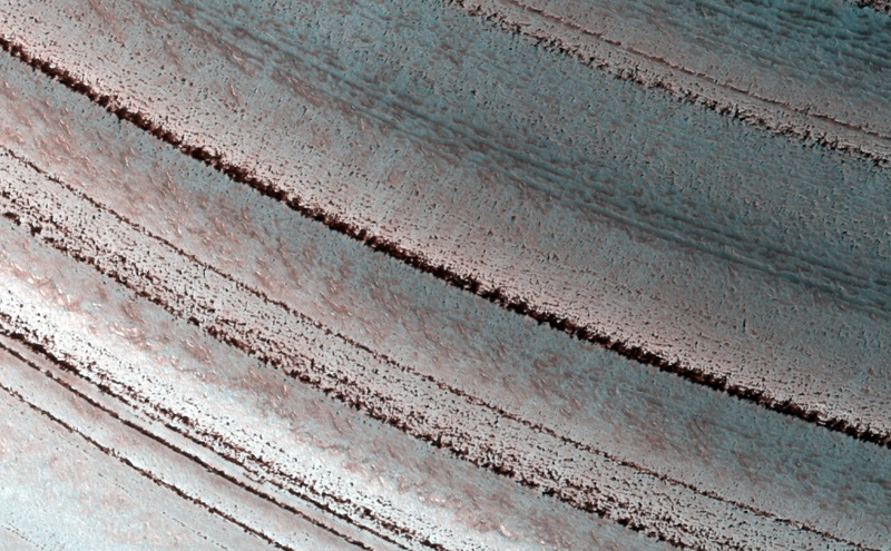 Icy Layers and Climate Fluctuations near the Martian North Pole View Related Images