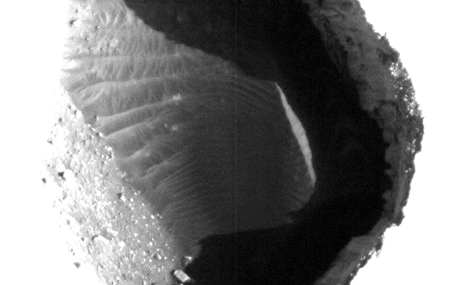 This enhanced image shows the inside of a rimless pit about 180 meters (591 feet) in diameter, northwest of the mountain Ascraeus Mons in the northern hemisphere of Mars.