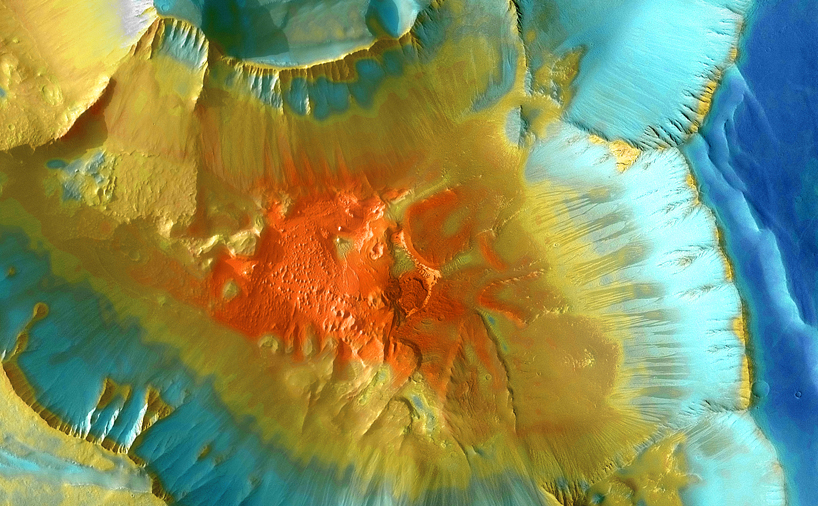 A false-color mosaic focuses on one junction in Noctis Labyrinthus where canyons meet to form a depression 4,000 meters (13,000 feet) deep.