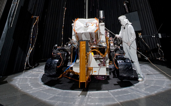 This image shows preparation for March 2011 testing of the Mars Science Laboratory rover, Curiosity, in a 25-foot-diameter (7.6-meter-diameter) space-simulation chamber. The testing was designed to put the rover through operational sequences in environmental conditions similar to what it will experience on the surface of Mars.