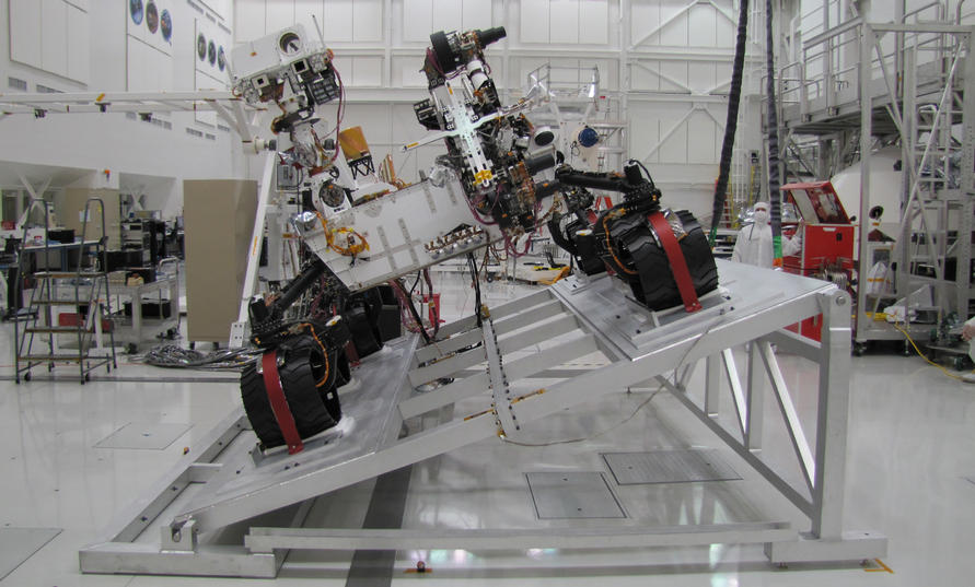 "The Mast Camera (Mastcam) on NASA's Mars rover Curiosity has two rectangular ""eyes"" near the top of the rover's remote sensing mast. The mast is on the right side of the rover, which puts it on the left side of this image taken from in front of the rover."