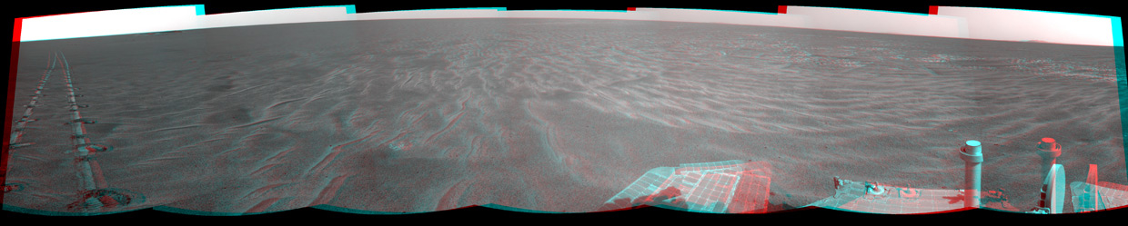 A dance-step pattern is visible in the wheel tracks near the left edge of this scene recorded in stereo by the navigation camera on NASA's Mars Exploration Rover Opportunity during the 2,554th Martian day, or sol, of the rover's work on Mars (April 1, 2011).