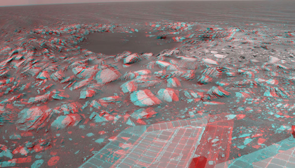 "NASA's Mars Exploration Rover Opportunity used its navigation camera to take the exposures combined into this stereo view of a wee crater, informally named ""Skylab,"" along the rover's route."