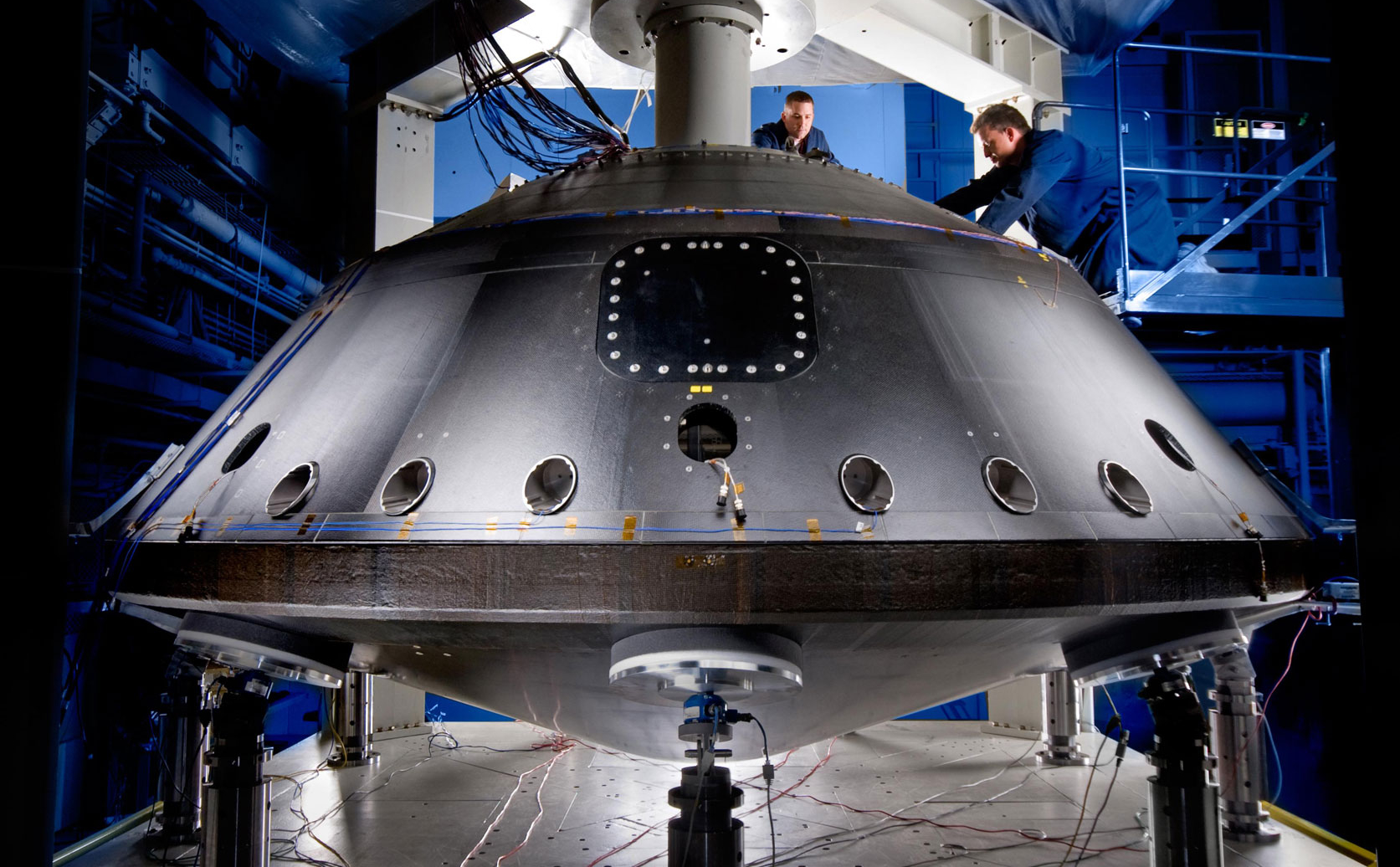 This image from July 2008 shows the aeroshell for NASA's Mars Science Laboratory while it was being worked on by spacecraft technicians at Lockheed Martin Space Systems Company near Denver.