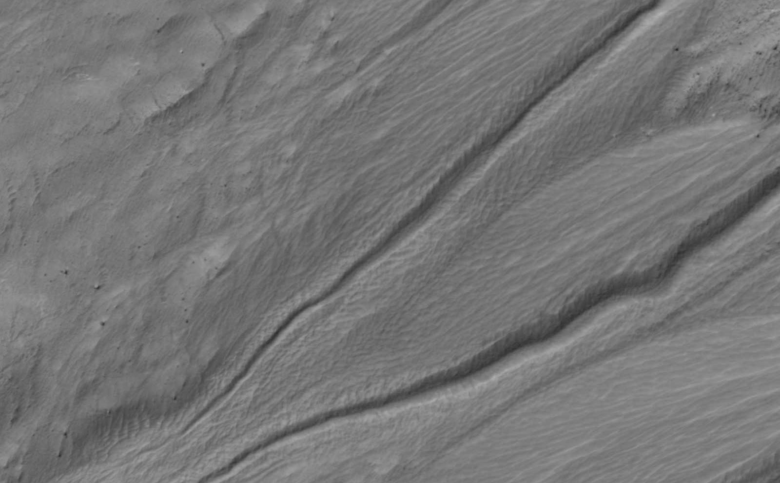 This back and forth comparison shows changes that occurred in a gully on a south-facing slope in middle southern latitudes of Mars.