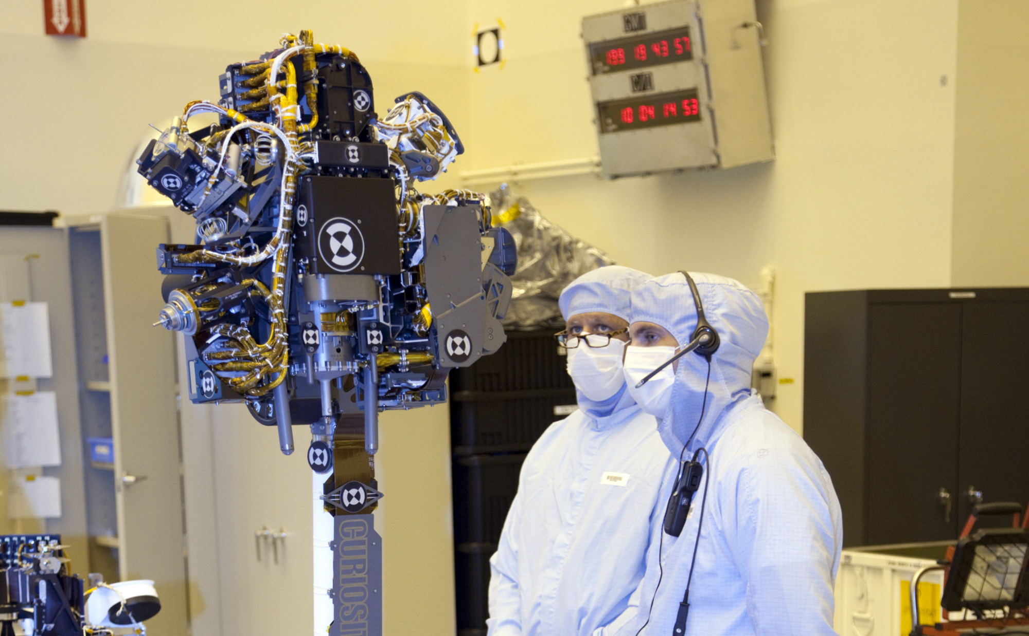 Technicians at the Payload Hazardous Servicing Facility at NASA's Kennedy Space Center in Florida, put the instrument mast and science boom on NASA's Mars Science Laboratory (MSL) rover, known as Curiosity, through a series of deployment tests.