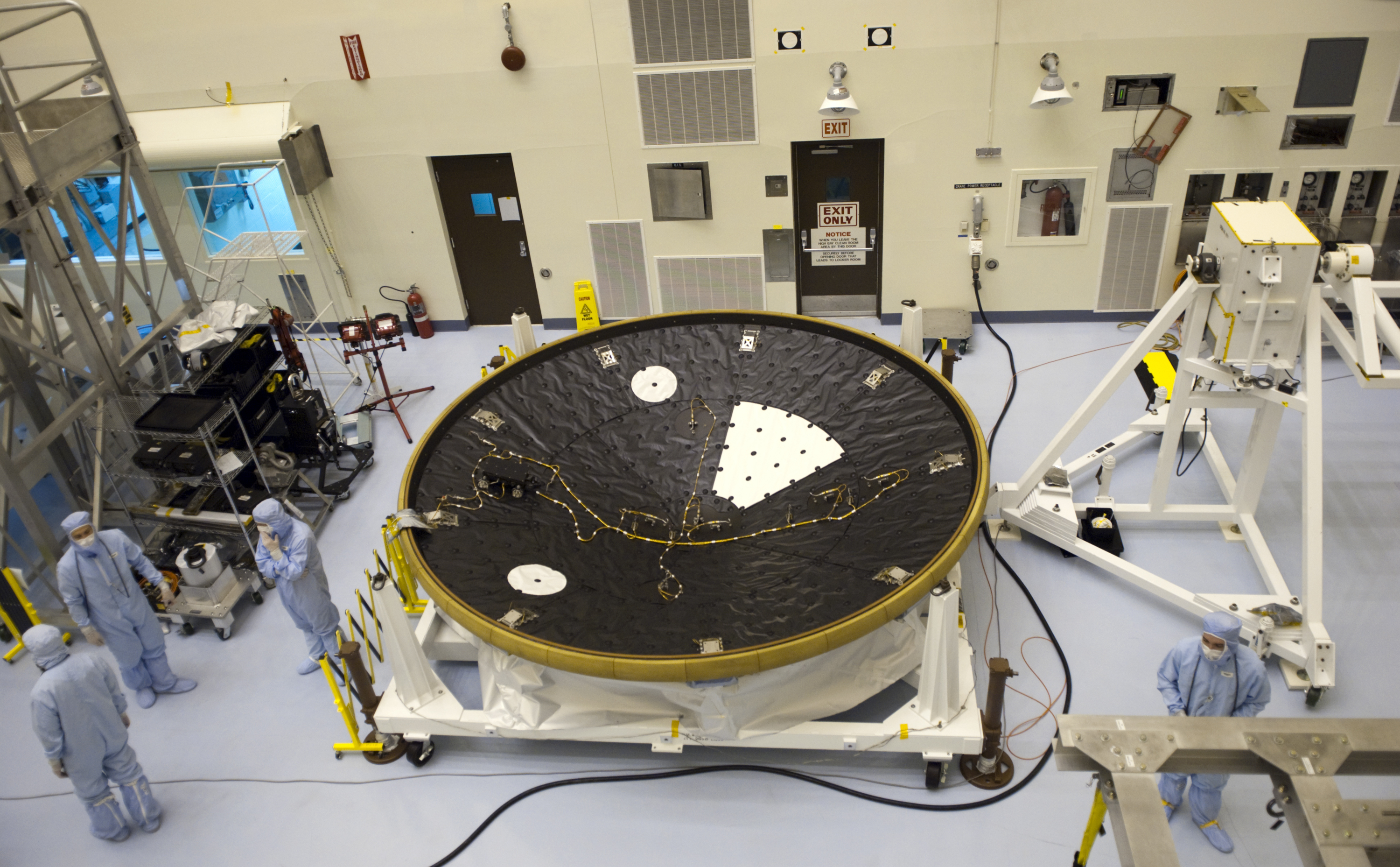 In the Payload Hazardous Servicing Facility at NASA's Kennedy Space Center in Florida, technicians process the heat shield for NASA's Mars Science Laboratory (MSL).