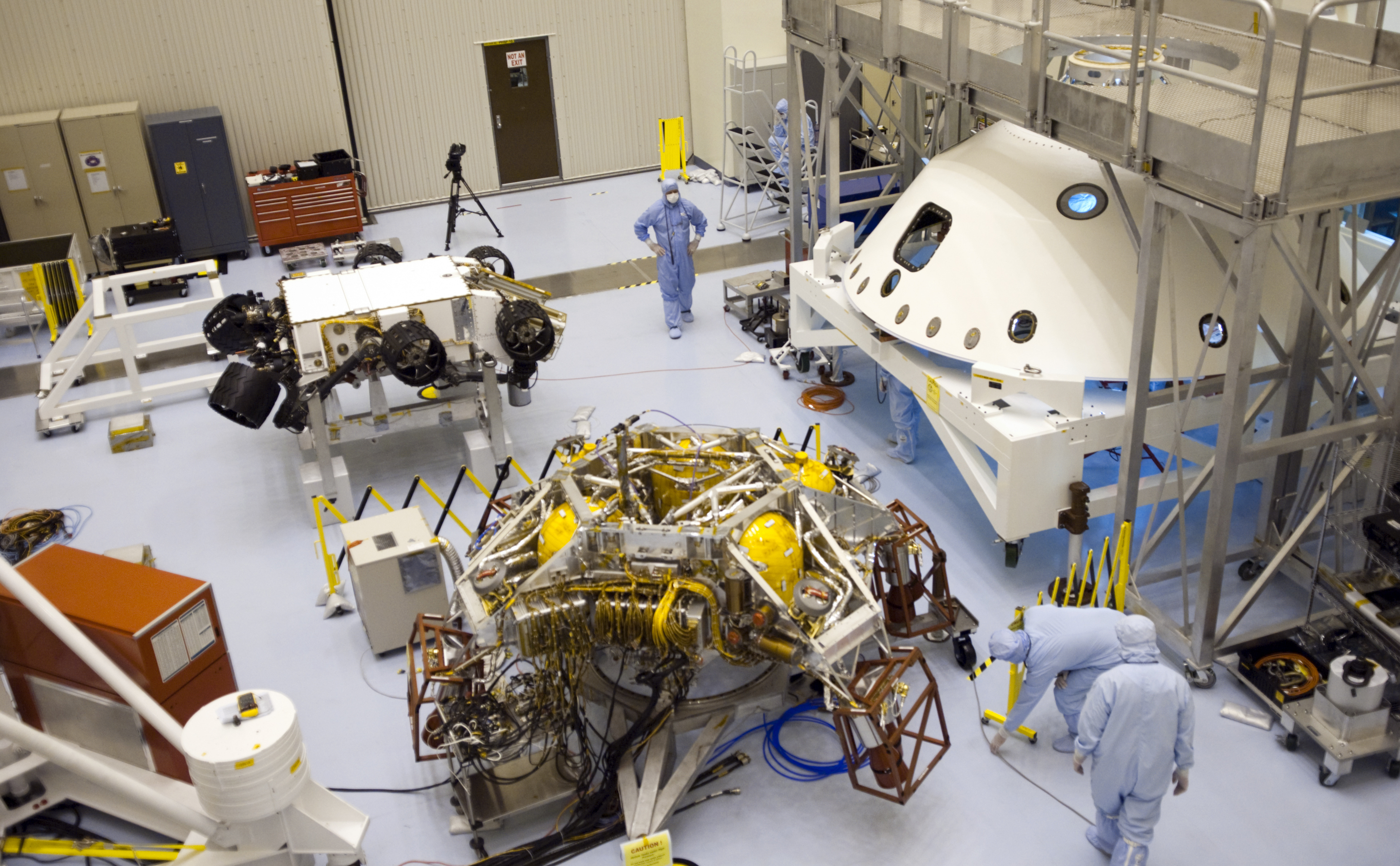 In the Payload Hazardous Servicing Facility at NASA's Kennedy Space Center in Florida, NASA's Mars Science Laboratory (MSL) rover, known as Curiosity, is being prepared to be moved to a rotation fixture for testing.