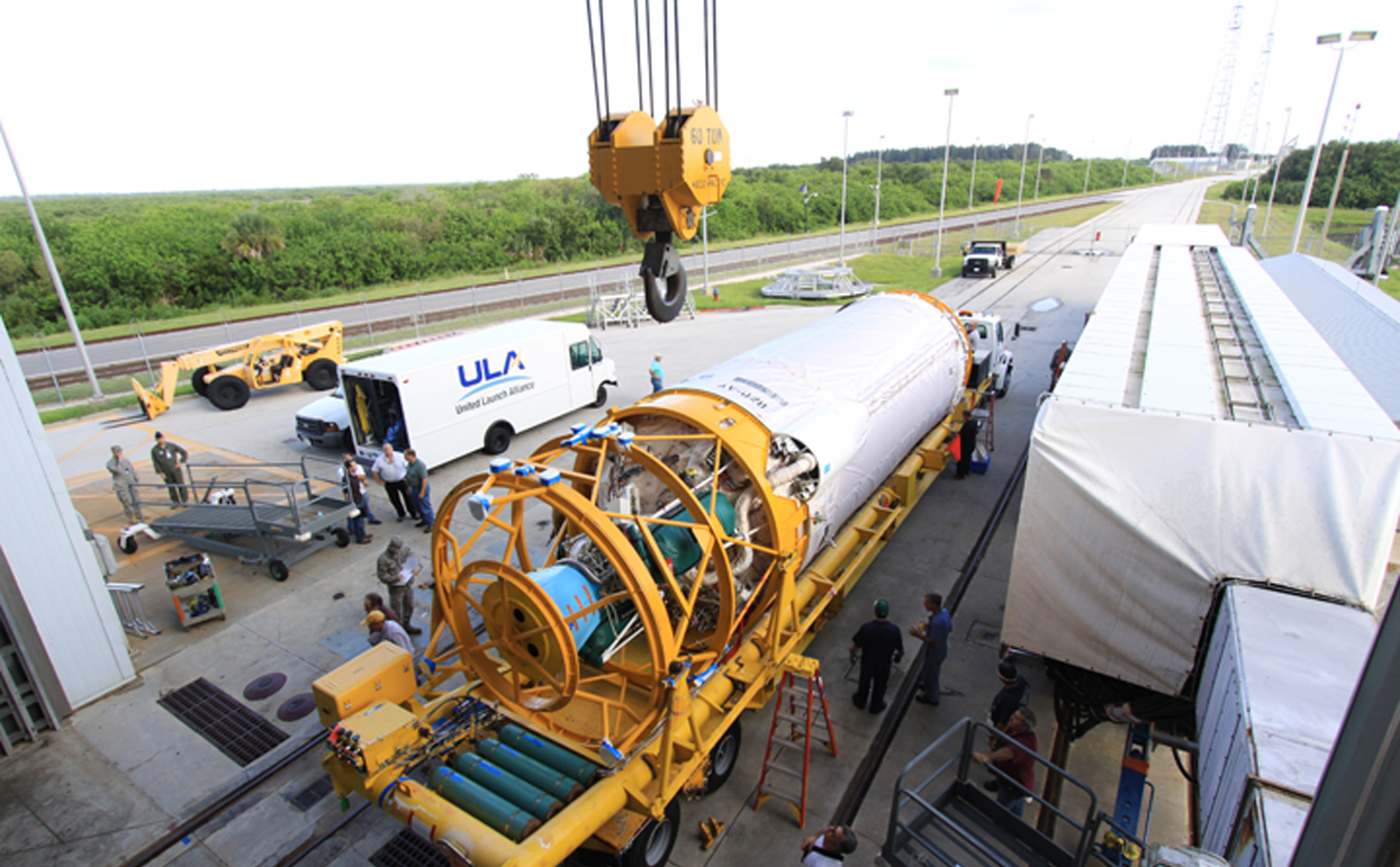 At Launch Complex 41 at Cape Canaveral Air Force Station in Florida, an overhead crane will be used to lift the Centaur upper stage for the United Launch Alliance Atlas V into the Vertical Integration Facility (VIF).