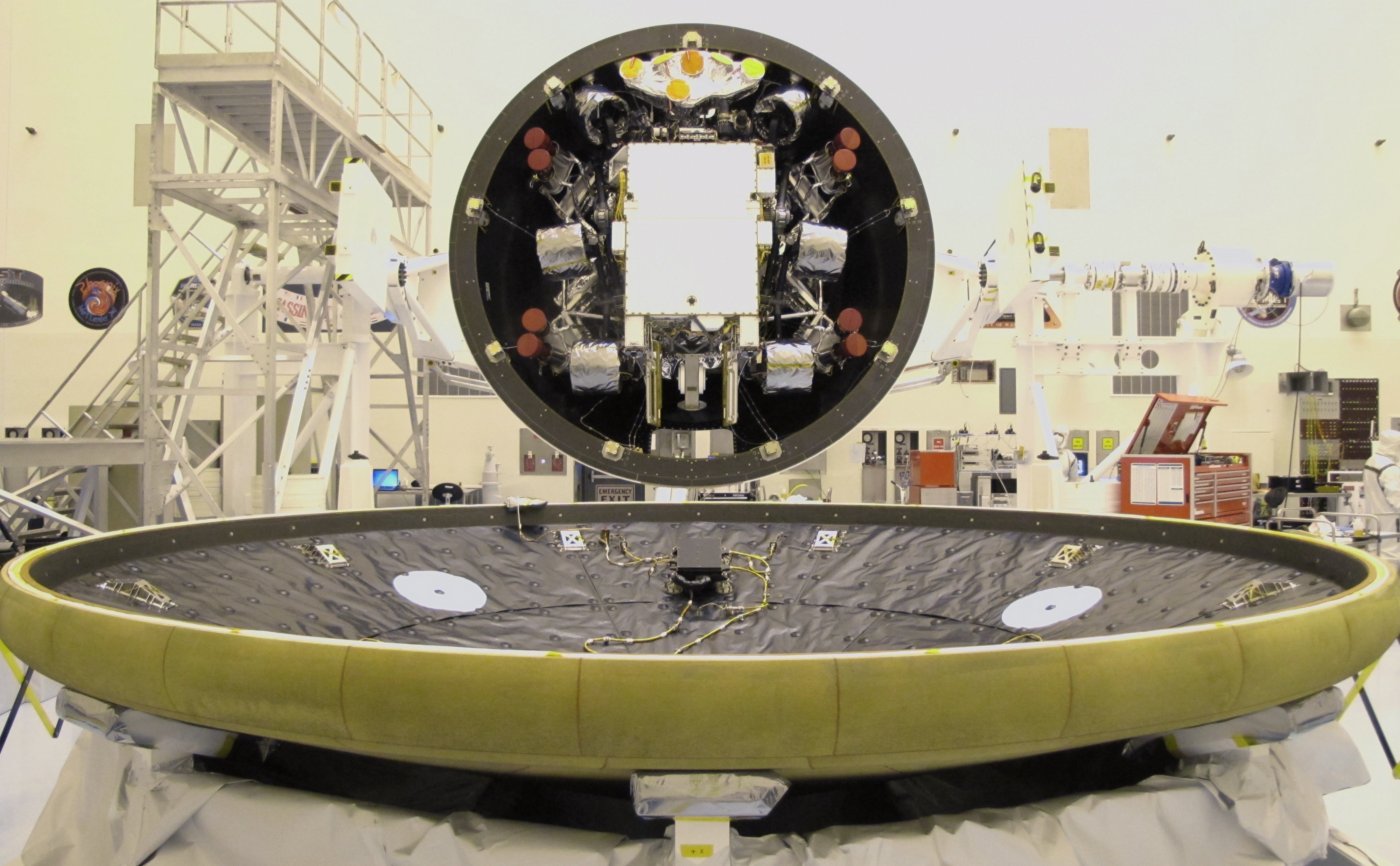 "At the Payload Hazardous Servicing Facility at NASA's Kennedy Space Center in Florida, the ""back shell powered descent vehicle"" configuration, containing NASA's Mars Science Laboratory rover, Curiosity, is being rotated for final closeout actions."