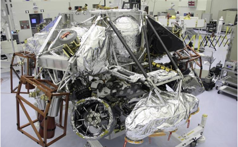 "The Mars Science Laboratory mission's ""powered descent vehicle"" is the integrated combination of the spacecraft's descent stage and the rover Curiosity. It is shown inside the Payload Hazardous Servicing Facility at NASA Kennedy Space Center, Fla. in this photograph taken during final assembly of the spacecraft."