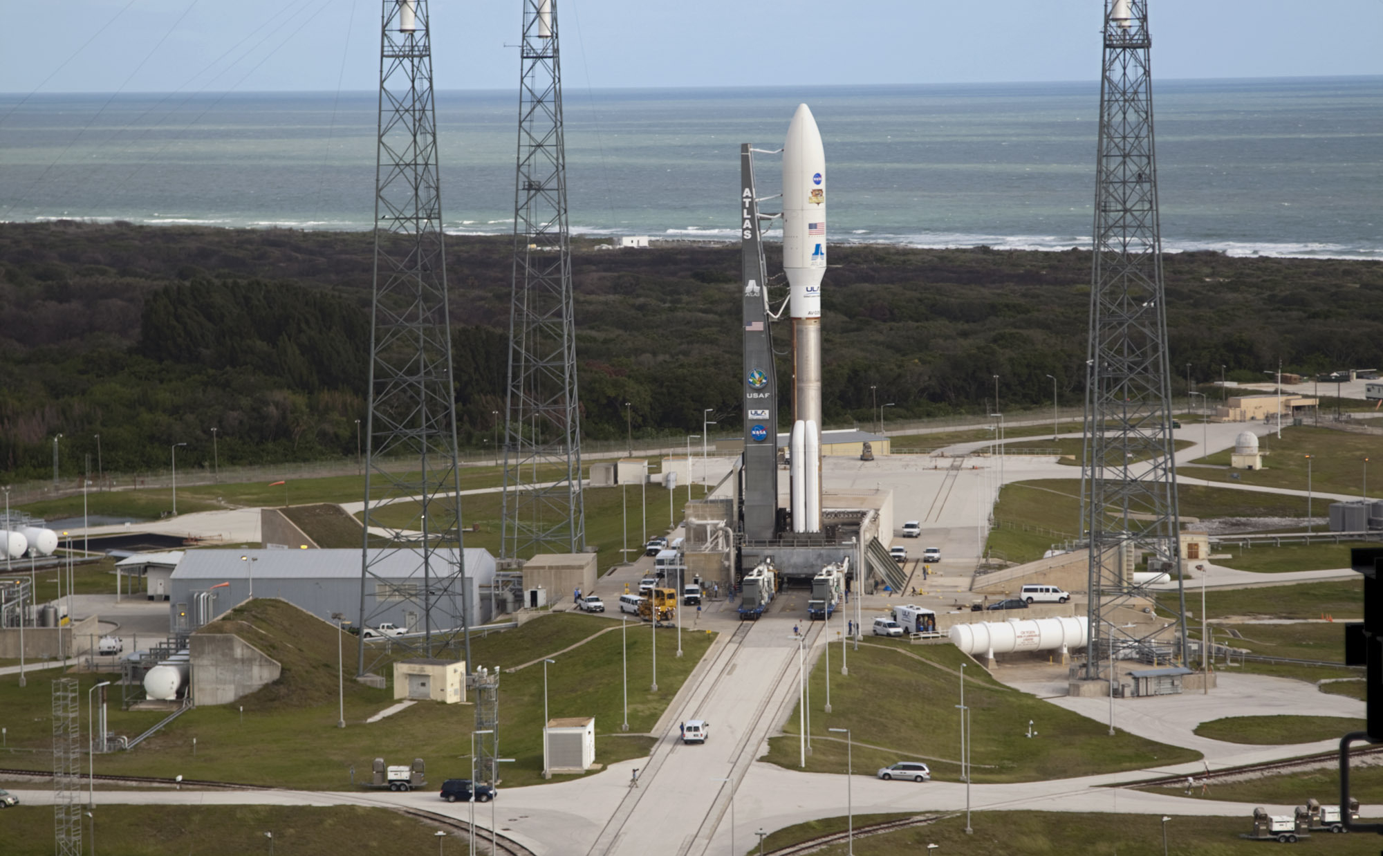 On Cape Canaveral Air Force Station in Florida, the 197-foot-tall United Launch Alliance Atlas V rocket is in place at Space Launch Complex 41 after rolling out from the nearby Vertical Integration Facility (VIF).