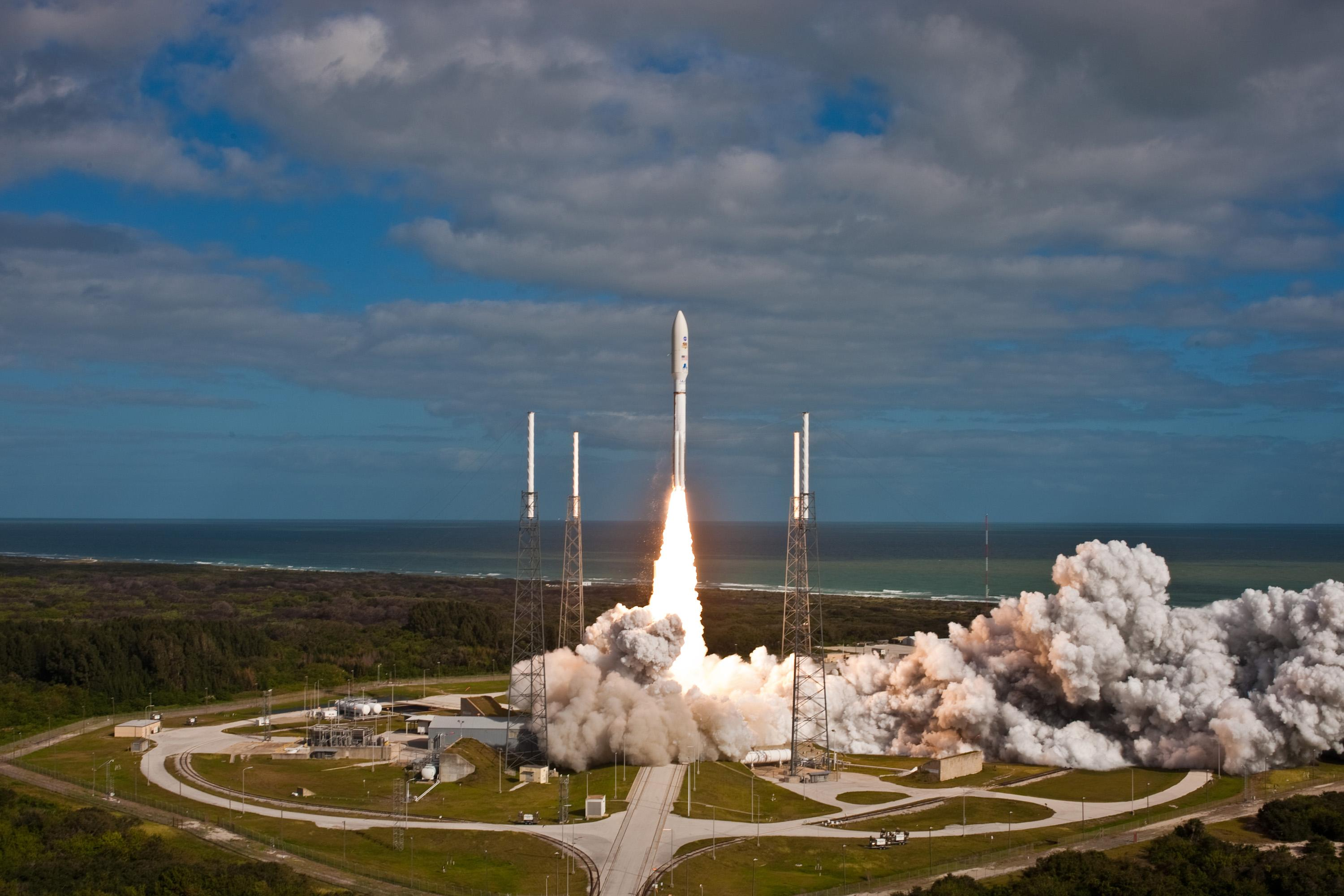 NASA's Mars Science Laboratory spacecraft, sealed inside its payload fairing atop the United Launch Alliance Atlas V rocket, clears the tower at Space Launch Complex 41 on Cape Canaveral Air Force Station in Florida.