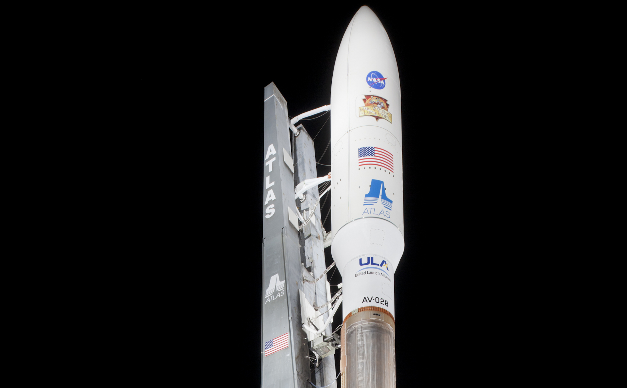 With NASA's Mars Science Laboratory (MSL) spacecraft sealed inside its payload fairing, the United Launch Alliance Atlas V rocket stands ready for launch at Space Launch Complex-41 on Cape Canaveral Air Force Station in Florida.