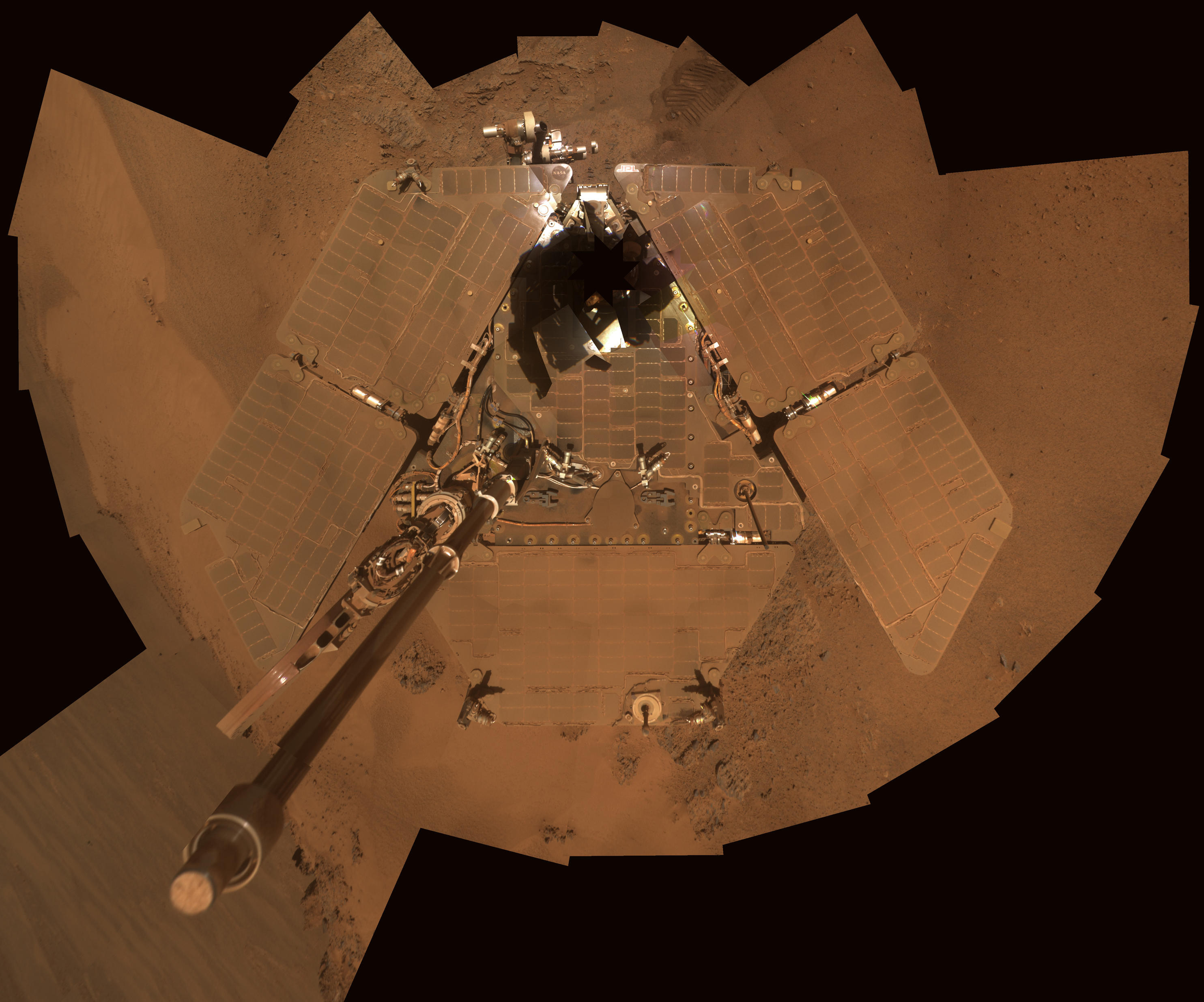 This self-portrait from Opportunity shows dust accumulation on the rover's solar panels as the mission approached its fifth Martian winter.