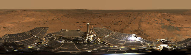 "Hundreds of images taken by Spirit were combined into this 360-degree view of ""Husband Hill Summit"" and the rover's deck."