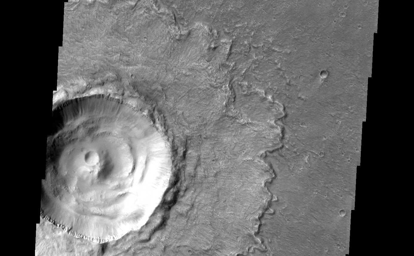 This crater, located in Chryse Planitia, is relatively unmodified, meaning it appears very much like it did when it first formed.