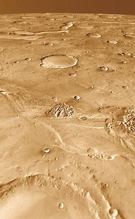 Around 200 kilometers long, Ravi Vallis was born in a flood of water from Aromatum Chaos (left). The racing waters sliced a pathway across Xanthe Terra, spawned at least two small chaos regions in the channel (center), and then hurtled over the plateau edge to disappear into another chaos region (right foreground). In the distance at left lies Orson Welles Crater and the meandering path of Shalbatana Vallis, a much longer outflow channel perhaps related hydrologically to Ravi.