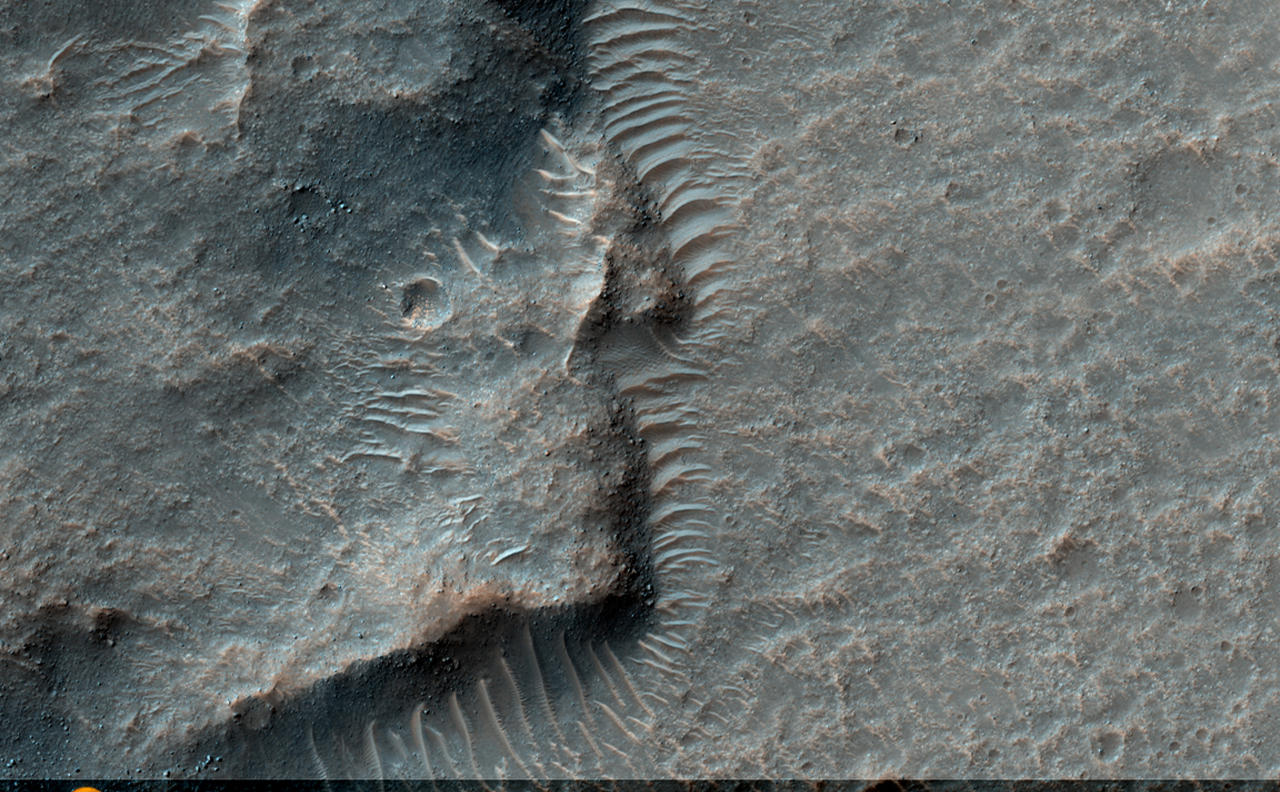 This observation shows a wrinkle ridge in Solis Planum, located in the Thaumasia region of Mars, a high-elevation volcanic plain located south of the Valles Marineris canyon system and east of the Tharsis volcanic complex. Solis Planum contains some of the most distinct and well studied arrays of wrinkle ridges on Mars.