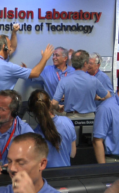 Engineers at NASA's Jet Propulsion Laboratory in Pasadena, Calif., celebrate the landing of NASA's Curiosity rover on the Red Planet. The rover touched down on Mars the evening of Aug. 5 PDT (morning of Aug. 6 EDT).
