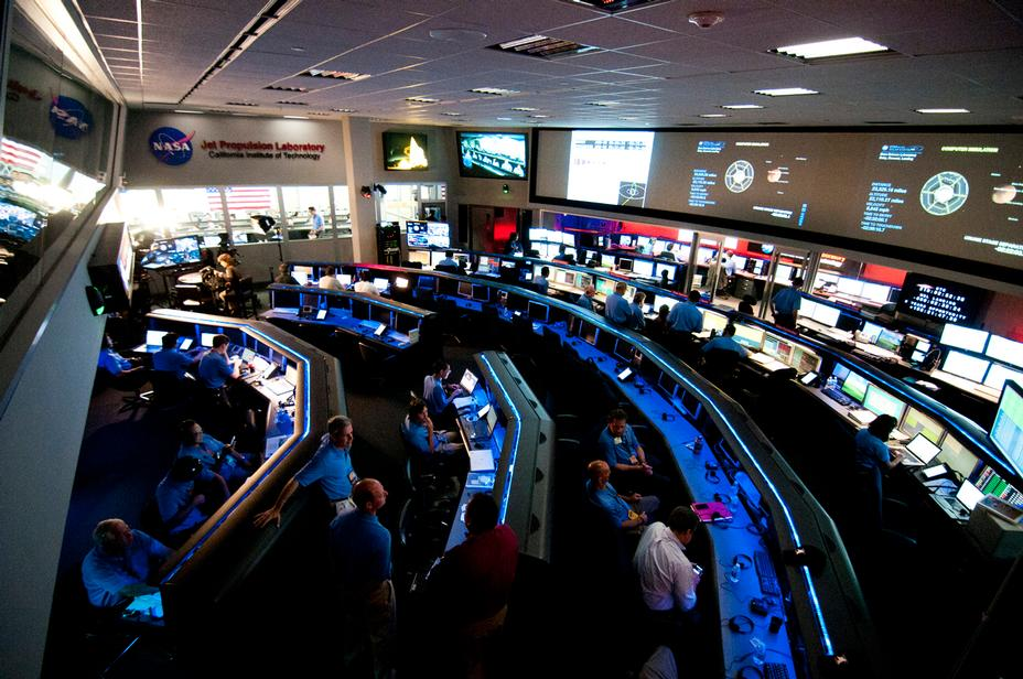 As the Curiosity rover hurdles toward Mars on the last leg of its journey, the Mars Science Laboratory Mission Operations Team assemble in Mission Control at the Space Flight Operations Facility at NASA's Jet Propulsion Laboratory in Pasadena, Calif.