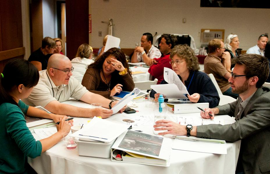 A group of teachers discusses solutions to a problem-solving activity at the Aug. 5, 2012, Curiosity Educator Workshop at NASA's Jet Propulsion Laboratory in Pasadena, Calif.