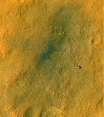 Tracks from the first drives of NASA's Curiosity rover are visible in this image captured by the High-Resolution Imaging Science Experiment (HiRISE) camera on NASA's Mars Reconnaissance Orbiter.