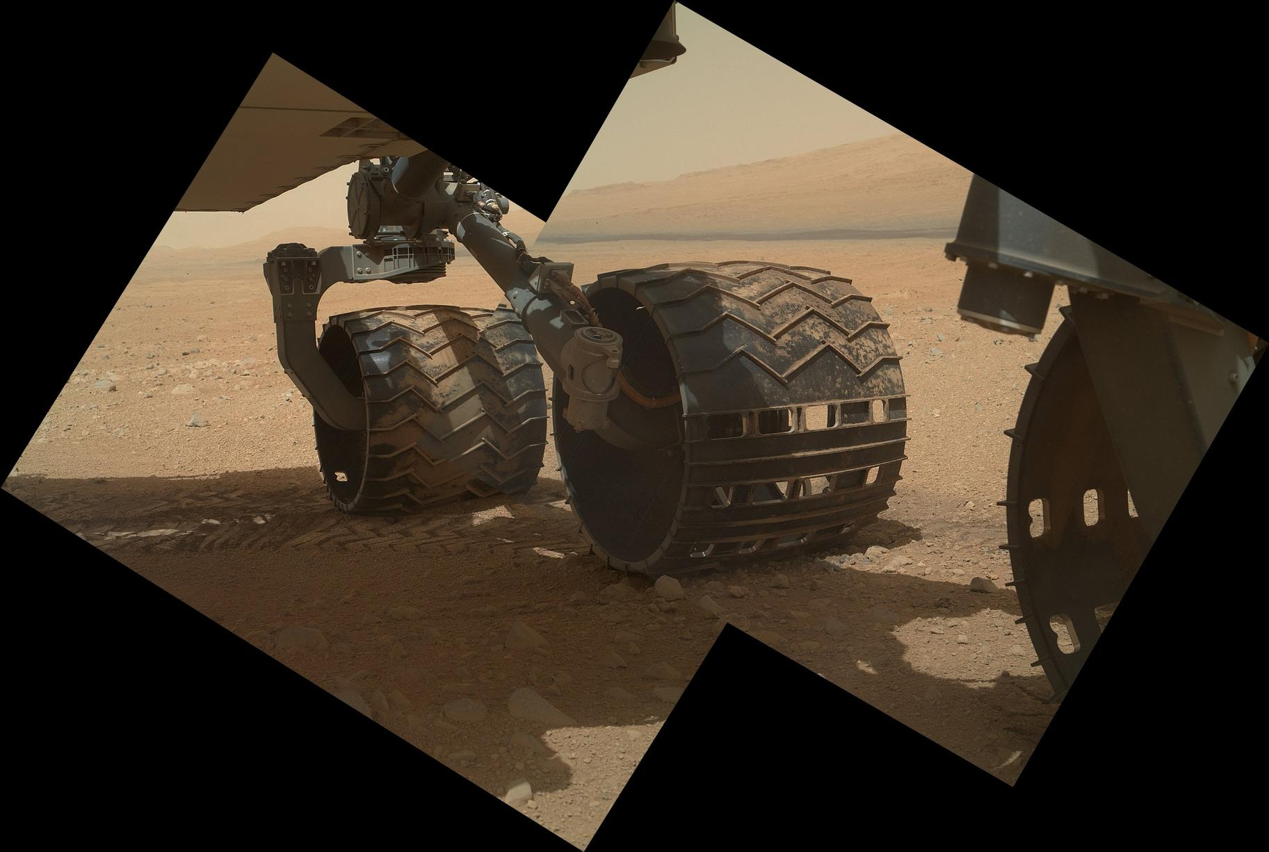 This view of the three left wheels of NASA's Mars rover Curiosity combines two images that were taken by the rover's Mars Hand Lens Imager (MAHLI) during the 34th Martian day, or sol, of Curiosity's work on Mars (Sept. 9, 2012).
