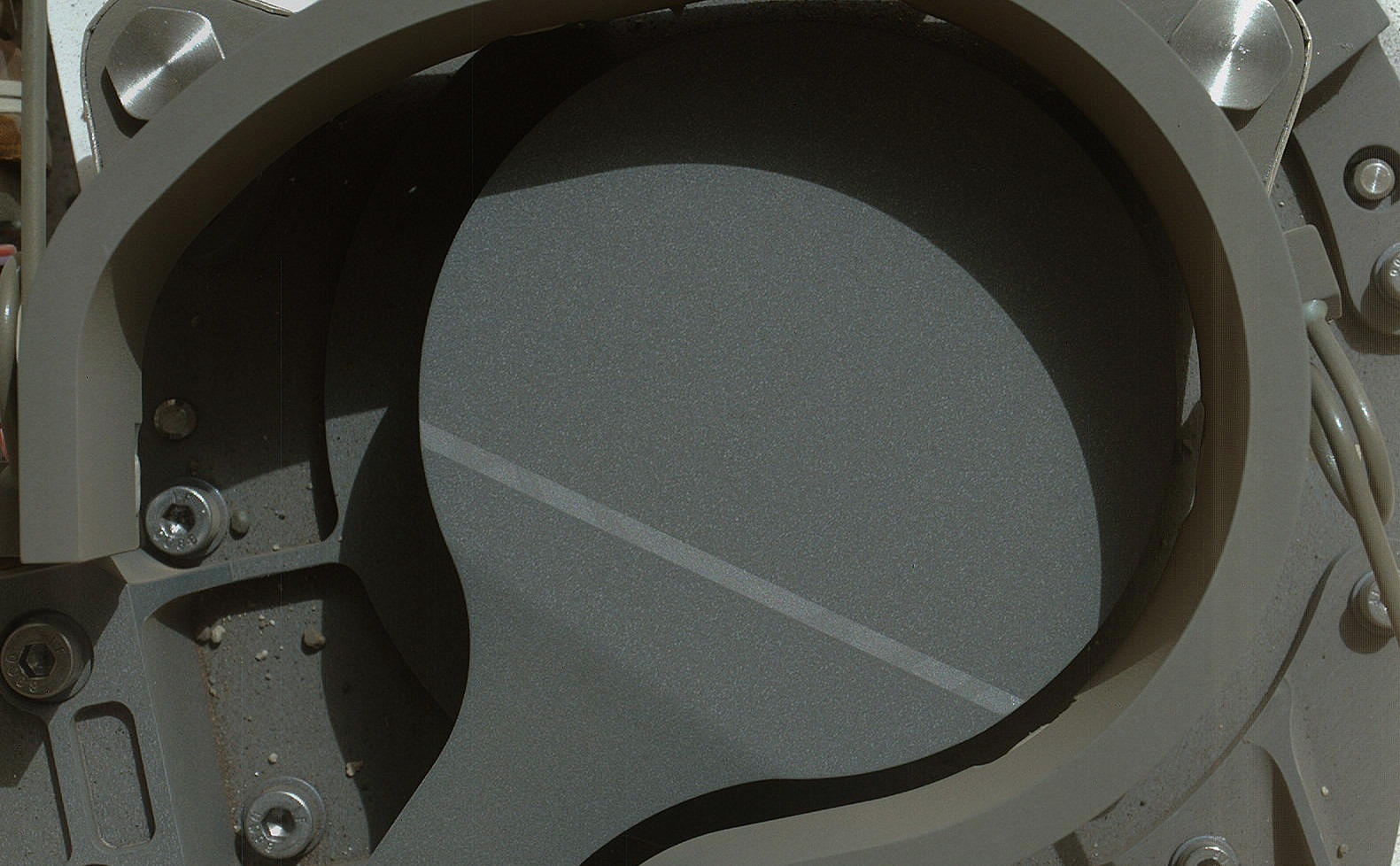 This image from NASA's Curiosity rover shows the cover on an inlet that will receive powdered rock and soil samples for analysis.
