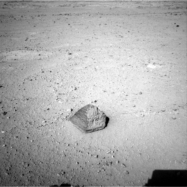 The drive by NASA's Mars rover Curiosity during the mission's 43rd Martian day, or sol, (Sept. 19, 2012) ended with this rock about 8 feet (2.5 meters) in front of the rover.