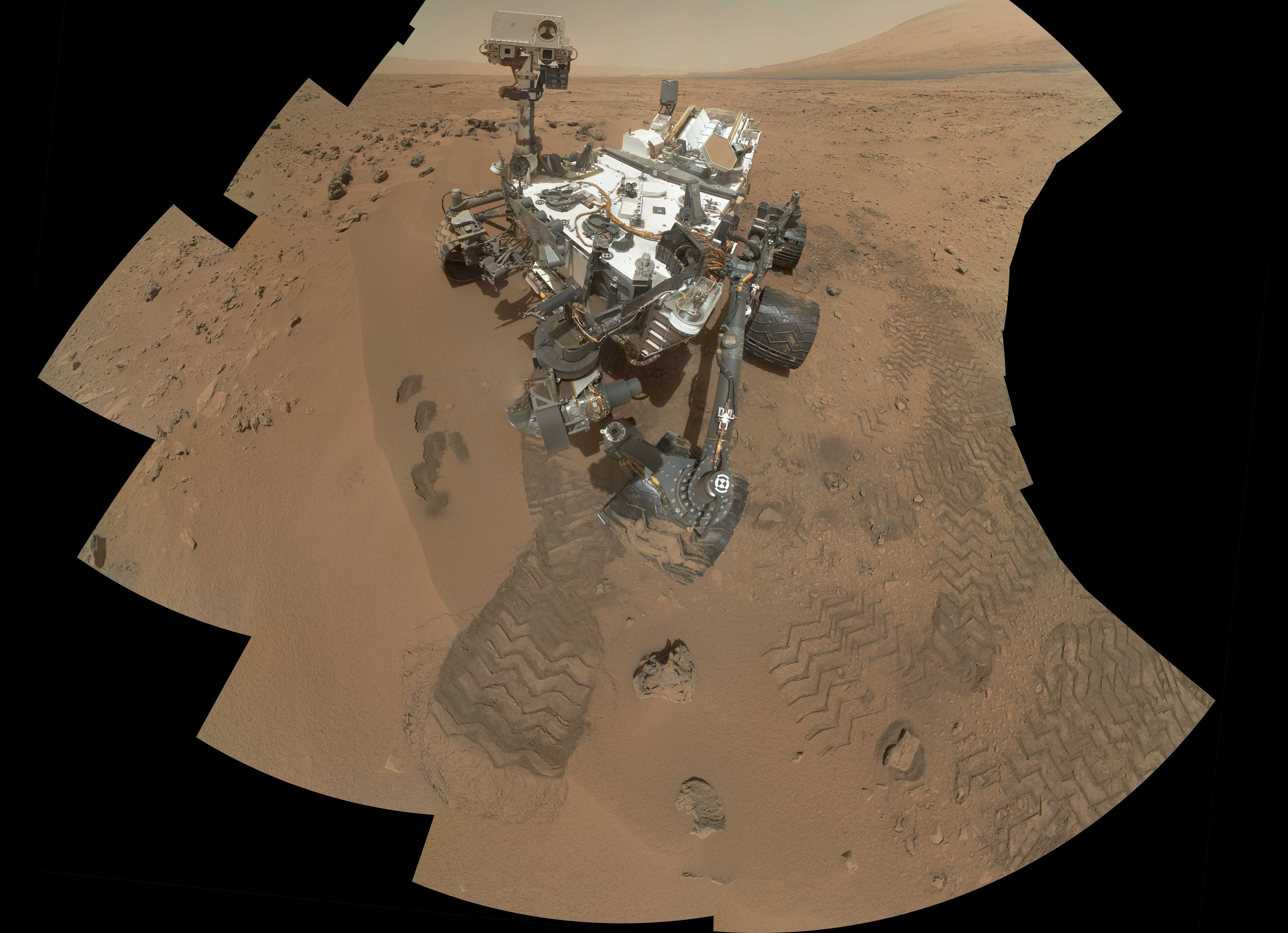 "NASA's Curiosity Mars rover documented itself in the context of its work site, an area called ""Rocknest Wind Drift,"" on the 84th Martian day, or sol, of its mission (Oct. 31, 2012)."