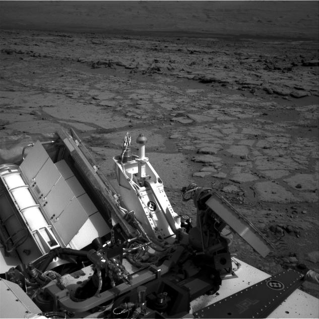 "The NASA Mars rover Curiosity used its left Navigation Camera to record this view of the step down into a shallow depression called ""Yellowknife Bay."""