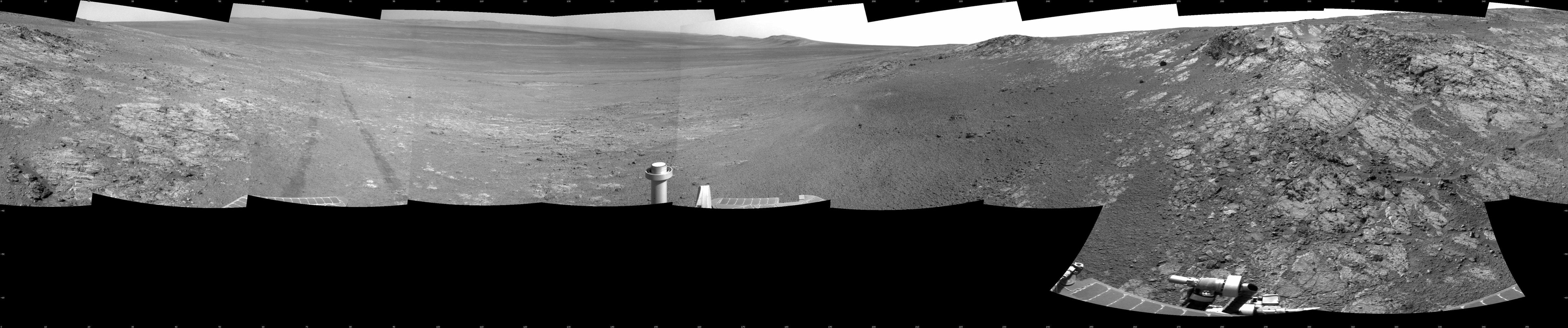This full-circle panorama shows the terrain around the NASA Mars Exploration Rover Opportunity during the 3,105th Martian day, or sol, of the rover's work on Mars (Oct. 18, 2012).