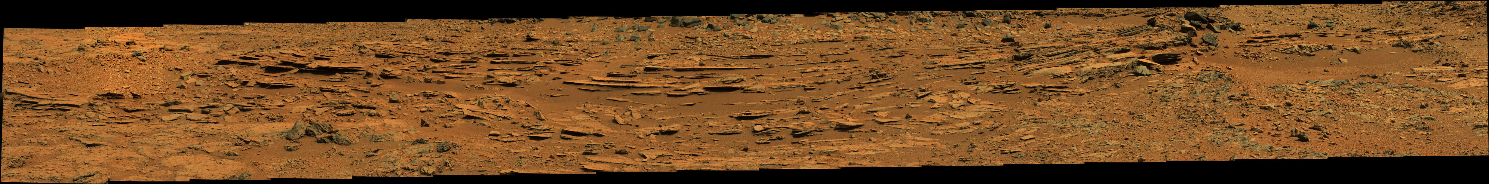 "The ""Shaler"" outcrop is dramatically layered, as seen in this mosaic of telephoto images from the right Mast Camera (Mastcam) on NASA's Mars rover Curiosity."