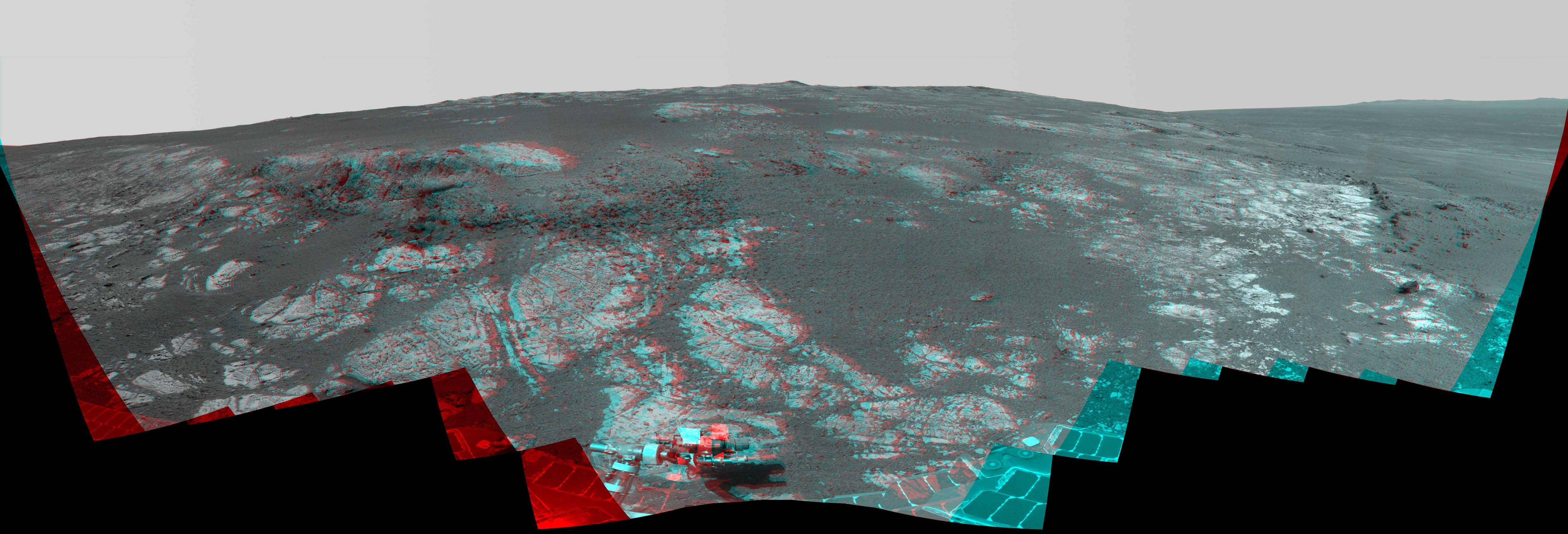 As NASA's Mars Exploration Rover Opportunity neared the ninth anniversary of its landing on Mars, the rover was working in the 'Matijevic Hill' area seen in this stereo view from Opportunity's panoramic camera (Pancam).
