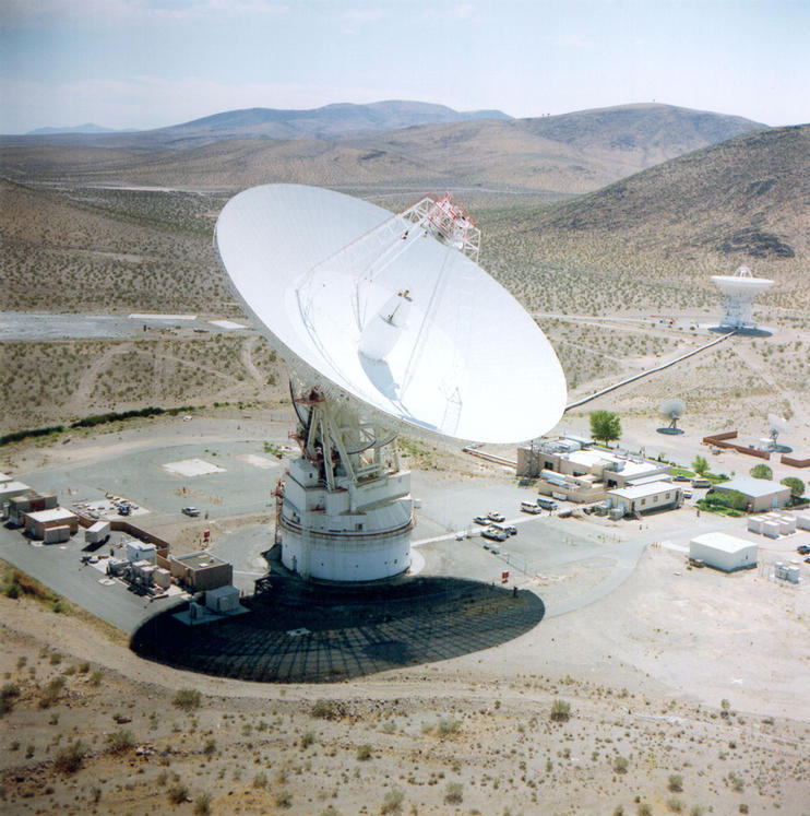 The 70m antenna at Goldstone, California against the background of the Mojave desert.