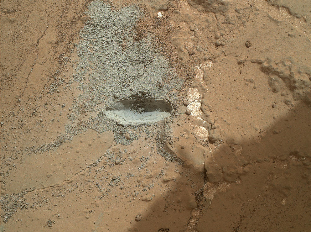 "The bit in the rotary-percussion drill of NASA's Mars rover Curiosity left its mark in a target patch of rock called ""John Klein"" during a test on the rover's 176th Martian day, or sol (Feb. 2, 2013), in preparation for the first drilling of a rock by the rover."