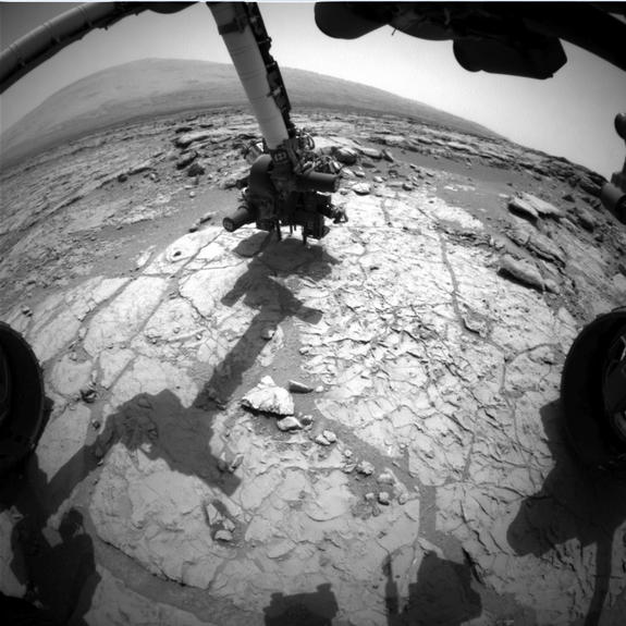 An animated set of three images from NASA's Curiosity rover shows the rover's drill in action on Feb. 8, 2013, or Sol 182, Curiosity's 182nd Martian day of operations.