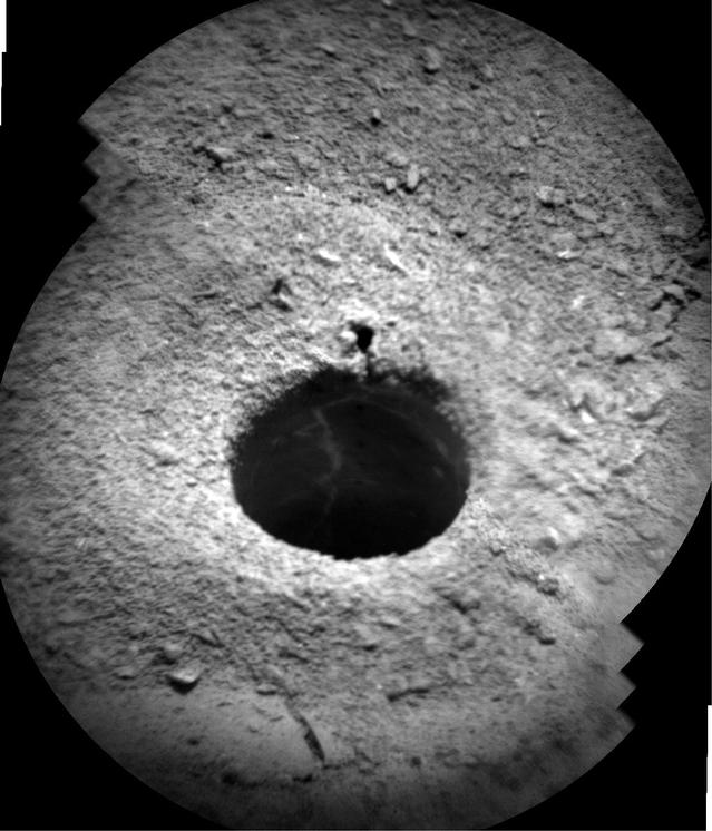 NASA's Curiosity Mars rover targeted the laser of the Chemistry and Camera (ChemCam) instrument with remarkable accuracy for assessing the composition of the wall of a drilled hole and tailings that resulted from the drilling.