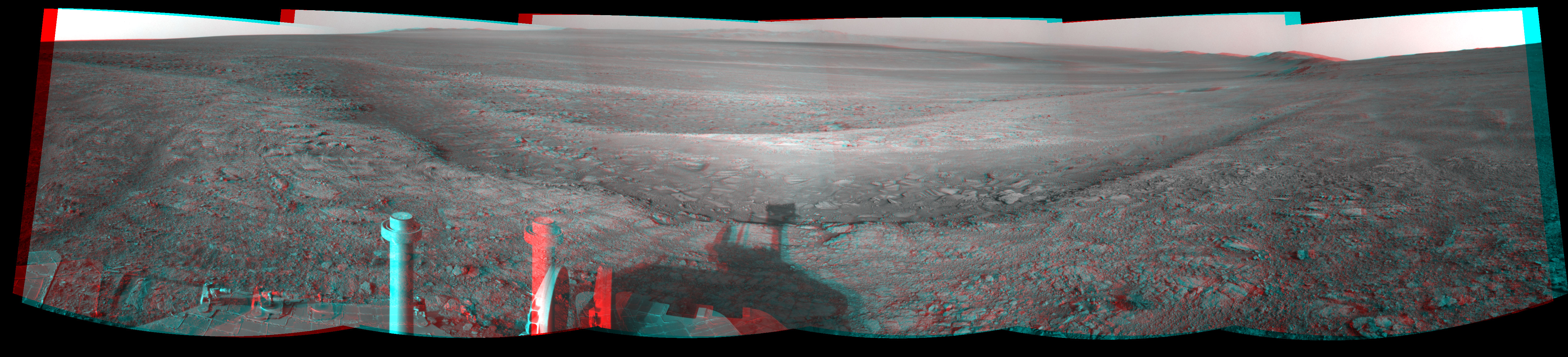 This stereo view from the navigation camera on NASA's Mars Exploration Rover Opportunity shows a vista across Endeavour Crater, with the rover's own shadow in the foreground.