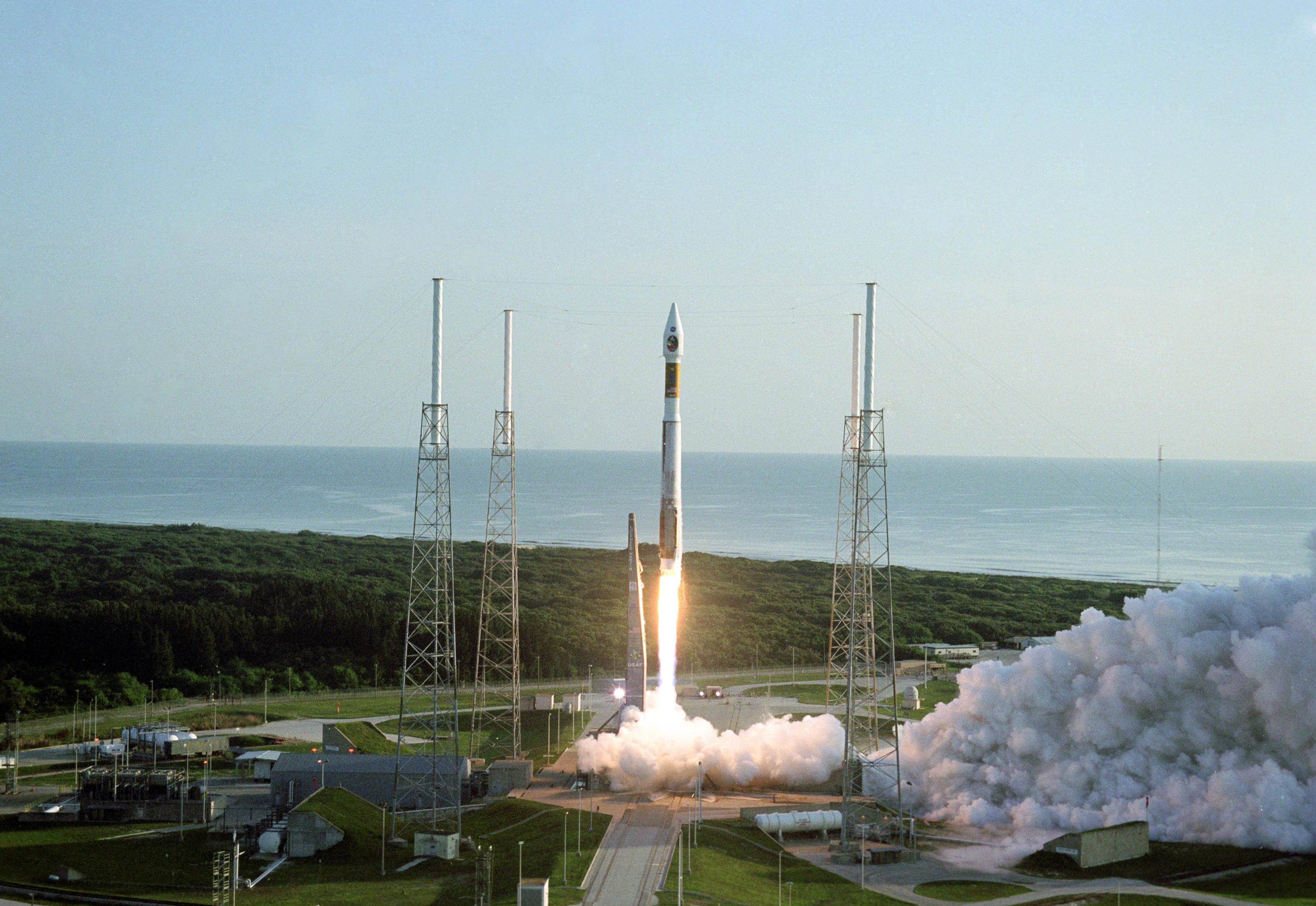 With the Atlantic Ocean as a backdrop, an Atlas V launch vehicle, 19 stories tall, with a two-ton Mars Reconnaissance Orbiter on top, roars away from Launch Complex 41 at Cape Canaveral Air Force Station at 7:43 a.m. EDT on Aug. 12, 2005.