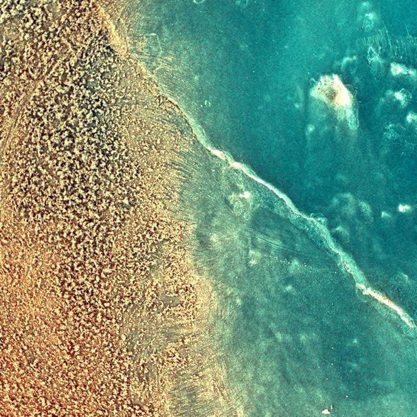 "The enhanced-color image taken by the microscopic imager on the Mars Exploration Rover Spirit shows the rock dubbed ""Mazatzal"" after a portion of its surface was brushed clean by the rover's rock abrasion tool."