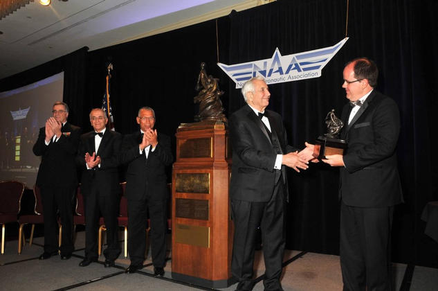 NASA's Mars Science Laboratory mission, which landed the rover Curiosity on Mars in August 2012, accepts the Robert J. Collier Trophy from the National Aeronautic Association at a ceremony in Arlington, Va., on May 9, 2013.